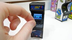 Super Impulse, the company responsible for making everything from miniature Rubik's Cubes to keychain-sized versions of Stretch Armstrong, is coming out with a new series of four incredibly tiny arcade cabinets featuring officially licensed versions of Pac-Man, Ms. Pac-Man, Space Invaders, and Galaxian.