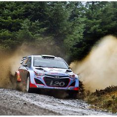 Hayden Paddon, driver for the Hyundai WRC team, powering through a watersplash on the Gartheiniog stage of Wales Rally GB.