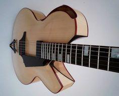 Wall   VK Beautiful Guitars, Guitar Design, Cello, Acoustic Guitar, Musical Instruments, Bass, Arch, Construction, Boutique