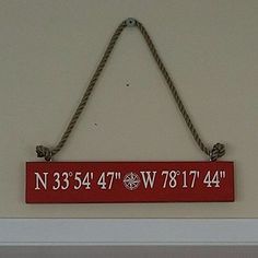 """Hand Painted GPS Coordinates Wall Board, Custom Latitude and Longitude Sign. Do you have a special place that you love to visit or a place that makes you smile? If so, commemorate that with the longitude and latitude address coordinates. I hand paint this on a piece of re-purposed wood. The typical sign is 1 (depth) x 5 (height) x 27 (width) and the lettering is painted with 3"""" x 24"""" dimensions. Please note - these are approximate dimensions based on regular coordinates (as shown in the..."""