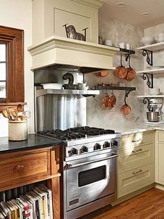 Ditch heavy wall cabinets in favor of open shelves in a small kitchen.  Also, note the copper pots hang from unfinished steel hooks on dual purposed 'shelf / pot racks'.