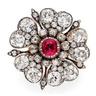 I love vintage jewels; A Victorian Ruby and Diamond Tudor Rose Ring-circa 1860.