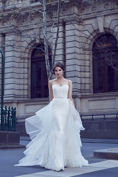 Bespoke Strapless corded lace gown, with soft fluted fitted skirt shape. Styled here with the Clarisse Train - Mille Feuille layers of circle organza panels.