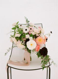 Anemone and chrysanthemum wedding bouquet: http://www.stylemepretty.com/2017/04/28/fall-nyc-rooftop-wedding/ Photography: Heather Waraksa - http://heatherwaraksa.com/