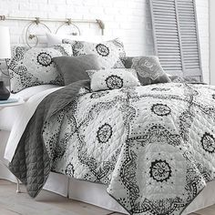 Relax and rewind in this sophisticated reversible quilt set. With blends of blues, your bedroom is sure to be more relaxing than ever. Polyester microfiber wit