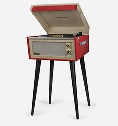 The Dansette Bermuda Record Player by Crosley is a furniture-like turntable for retro lovers who love listening their analog vinyl records in style!