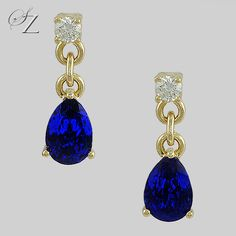 Striking 'cornflower blue' hued Tanzanite pears fall elegantly from a Diamond stud to create these beautiful earrings. Timeless and extremely elegant.