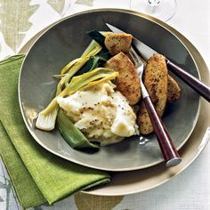 Boudin Blanc with Leeks and Mustard Sauce - Chef Marcia Kiesel created this simple but luxurious dish, begin with the classic French veal and pork sausage boudin blanc, often served with a black truffle-flecked cream sauce. In her riff on the dish, she replaces the pungent truffles with smooth Dijon and grainy mustards. http://www.foodandwine.com/recipes/boudin-blanc-with-leeks-and-mustard-sauce
