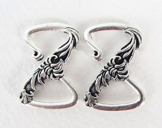 These are beautiful antiqued silver Z shaped flower hook clasps by TierraCast, sold in packs of 2 clasps. Beautifully detailed cast pewter