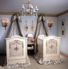 I don't know about the victorian creepy style but I love the idea of the curtain above the head of the crib
