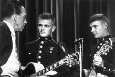 Ed Sullivan chats with US Marines, Phil and Don Everly