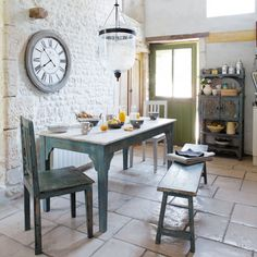 Kitchen. Entrancing Design Ideas Of French Country Style Kitchens. Pretty French Country Style Kitchen Features Rectangle Shape Wooden Dining Table And Armless Chairs And Wooden Rectangle Bench Along With White Bricks Wall And Also Pendant Lamps And Stone White Floor Tiles As Well As Rectangle Shape Wooden Storage Racks.
