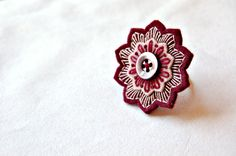 This adjustable ring is made of three layers of the highest quality merino wool felt in beige and burgundy. Each layer is hand embroidered in cotton thread. A vintage mother of pearl button is sewn to the center. Button Earrings, Stud Earrings, Felt Necklace, Embroidered Gifts, Textile Jewelry, Felt Flowers, Wool Felt, Etsy Seller, Brooch
