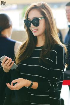 Jessica Jung in black with thin white stripe.