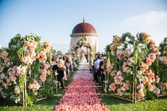 A wall of flowers... This pink wedding is gorgeous!