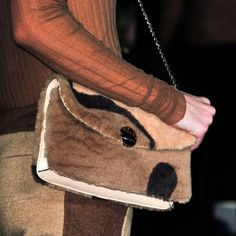 Check out this Marc Jacobs shearling bag straight off the runway. More of our favorite Fall 2014 accessories here.
