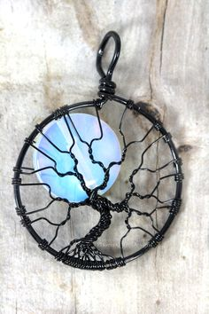 This Halloween inspired Full Moon Tree of Life Pendant features a beautiful Opalite Rainbow Moonstone moon peeking out between wire wrapped bare tree branches. The Tree of Life is a concept thats been featured in myth, story and legend literally all around the world. Since ancient