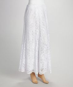 This skirt will make a welcome addition in any classic closet collection. Its lacy overlay and long silhouette suit the style maven who seeks a posh piece. Size note: For the best fit, please refer to the size chart.