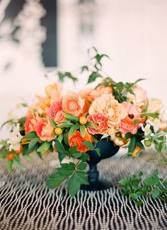 Center pieces - like this shape and the peaches. Would need more white and green throughout + different vase