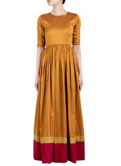 True Browns brings to you this alluring gathered dress that lets you sport an Indo-western chic look this season! Fashion in the truest form, the outfit shifts your clothing personality from cool casual to dressy in a jiffy. The raw silk dress features a round neck and three-quarter sleeves.