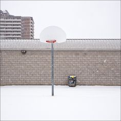 Hoop and garbage can.