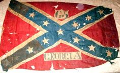 Flag of the 65th Georgia Inf Regt. After the first color bearers were killed,  Pvt John Davis of Co D carried the flag until the Battle of Franklin was over. He then stuffed it into his boot to protect it and brought it back home with him. He donated it to the Southern Museum of Civil War in Kennesaw Ga. The flag has over 40 bullet holes, and you can see the bloodstain of what is assumed to be William Martin, who was the color bearer killed at the Battle of Franklin and fell on top of the…
