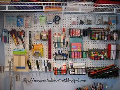 I like the peg board... perhaps spray painted a bright color for pizzazz and contrast.