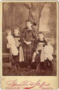 Twins & older sister with dolls by smieglitz, via Flickr