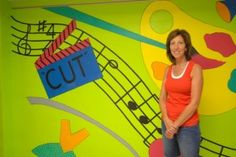 Artist Janet Arkelin led students to paint a mural on a wall in Lincoln Elementary School for the Arts' cafeteria.