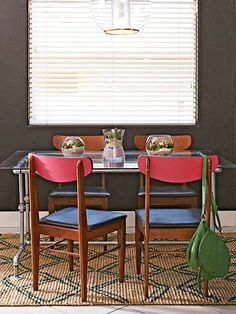 Against the glass-and-metal table, midcentury chairs offer color and warmth! Get more vintage stylings here: http://www.bhg.com/decorating/decorating-style/flea-market/house-tour--fresh-retro-style/?socsrc=bhgpin112514dineindiystyle&page=10