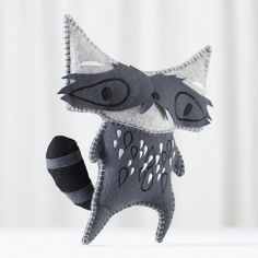 The Land of Nod Johan the Raccoon: Not only is Johan an awesome name, but The Land of Nod's plush raccoon ($25) lives up to it! Designed by artist Michelle Romo of Crowded Teeth, the raccoon has a masked face and floppy tail with patchwork and embroidered details.