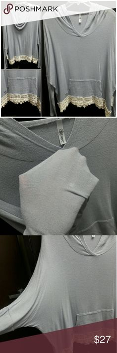 DAISIES by Daisy Shoppe Blue Hoodie w/ Lace Trim Brand New With Tags!! Size Large. 95% rayon, 5% spandex. Super cute and soft, light blue, light weight, a little sheer (perfect over a tank top!), has a front pocket, long sleeves, hood, and a cute lace trim on the bottom. Very comfy, stretchy, and cool. ... Ask me anything! Daisies Tops