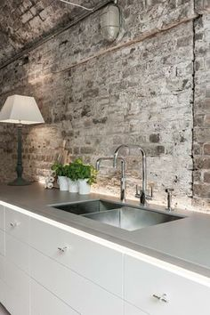 kitchen with brick wall and grey countertop ***