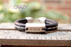 www.lovecrazydesigns.com  Black licorice leather with white stitching with silver plate and hand stamped initials of children!:)