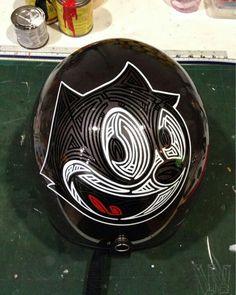 Felix the Cat. It's a half helmet but I need this lol