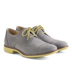 Cole Haan Gramercy Oxford Cap-Toe. If you look at a picture of the sole, they look just like tennis shoes. These would make great walking shoes.