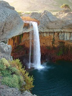 Agrio Falls in Argentina is surrounded by yellow and red basaltic rocks, giving it beautiful contrasting color.