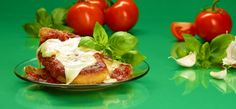"Perfectly seasoned and ""Breaded"" chicken with melted parmesan and topped with savory-sweet marinara and fresh basil."