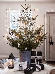 Beautiful bohemian black and white christmas tree set up with a vintage bucket as the tree base and Moroccan lantern for extra light. Get the look at MIX!