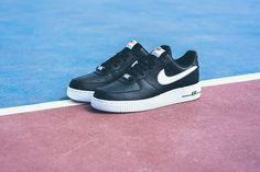 """Now, here's a classic you can't miss. The iconic Nike Air Force 1 silhouette receives a simple, minimal black and white makeup. The AF1 gets a crisp white sole with black """"AIR"""" detailing, while the up..."""