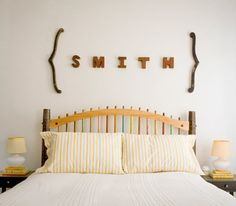 Easy to recreate this look – how about painted letters spelling a child's name over their bed?  Or maybe something like 'dream' or 'sleep' over a guest bed instead of a headboard?