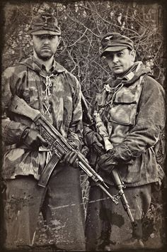 "CAVEAT: This is a modern re-enactment photo purporting to show two German Luftwaffe soldiers carrying an StG-44 Sturmgewehr and a sniper's rifle. The rifle may be genuine, but the StG-44 is an Air Soft replica. It is a modern digital image which has been intentionally and obviously ""aged"" with a computer-supplied dark margin, a sepia tone, and various mars and soiling blotches."