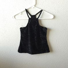 Velvet Crop Top PRICES FIRM UNLESS BUNDLED THROUGH BUNDLE FEATURE. My bundle discount is set at 15% off 2+ items. Absolutely beautiful stretchy floral velvet crop top. One size fits most. Brandy Melville. I do not trade, I do not model, and I do not sell on any other apps. Brandy Melville Tops Crop Tops