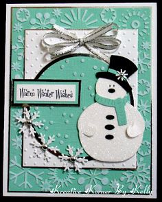 lovely handmade card for winter ... aqua and white with black details ... great die cut snowman with sparkly glitter... like the design with many layers but unified by color ...