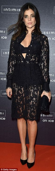 Stunners: French art director and model Julia Restoin Roitfeld was flashing the flesh in a completely sheer dress with buttons extended to reveal her underwear while she walked alongside model and actress Elisa Sednaoui who oozed glamour in navy leather trousers and a Chanel belt