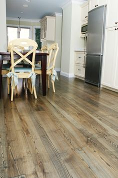 This is a character grade of solid Ash wood flooring with an ebony stain applied to darken it.  Ash is a strong and durable wood, ideal for kitchens and other high-traffic rooms.