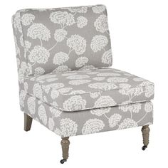 The Madrid accent chair features toile stems light grey fabric and medium grey solid wood caster legs.