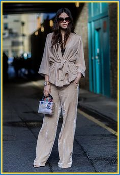 Blogger Doina Ciobanu wearing a velvet beige wrap Gestuz suit and tiny bag at London Collections:Men