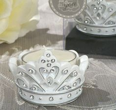 Add a royal touch to your event with these Sparkling Tiara Candle Holders. Each beautifully designed sparkling tiara resin candle holder is embellished in crown-like jewels and accented with a silver lining.