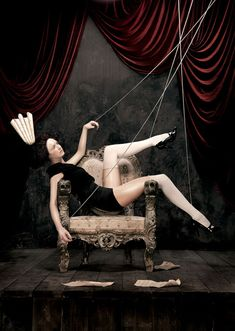 Marionettes who manipulate their own strings...